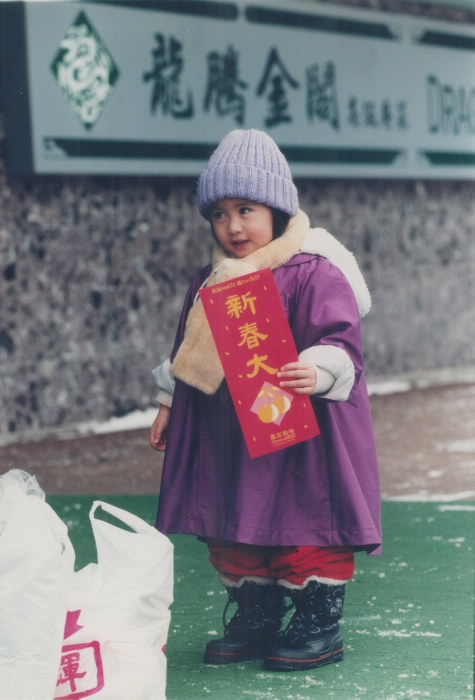 Ling, 3, who was born on Chinese New Year's Eve, holds lucky greeting
