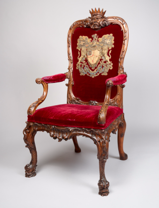 Director's chair with the East India Company arms embroidered on the crimson velvet, c. 1730. British Library, Foster 905
