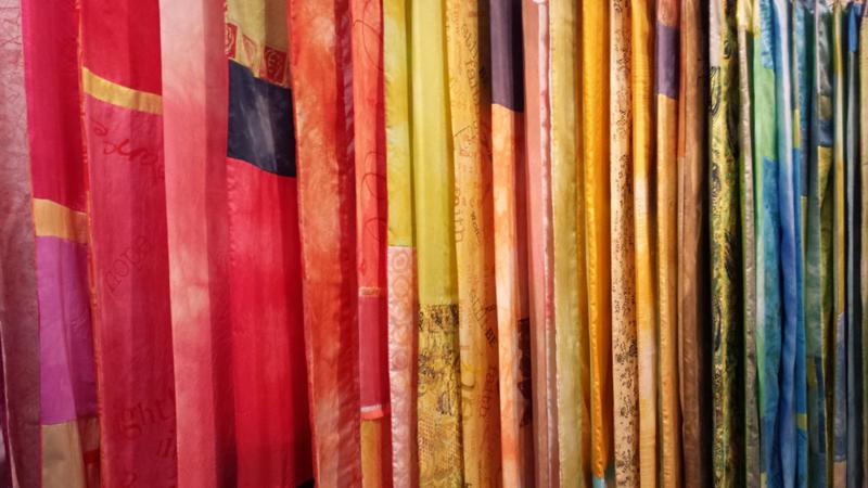 A rainbow of scarves!
