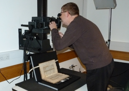 Neil Cowland preparing to photograph a manuscript in the Imaging Studios of the British Library.