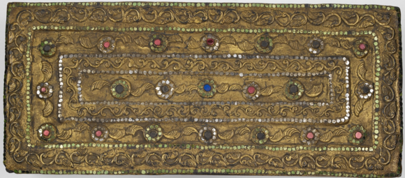 This Shan folding book (pap tup), dated 1885, with the title Buddhānussati contains a text on recollections of the Buddha, explaining mindfulness with the Buddha's virtues as objects. The embossed gilded covers are studded with multi-coloured mirror glass for ornate floral decoration. British Library, Or.12040, front cover.