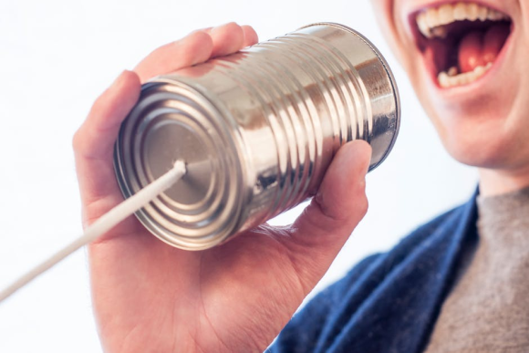Person talking through a Tin can telephone