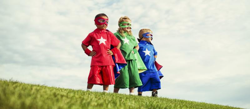 Kids in superhero costumes