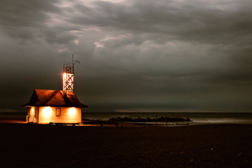 Lifeguard station with a grey, stormy sky behind it