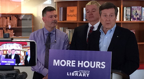 Somebody and Paul Ainslie with John Tory at Cedarbrae Branch press conference
