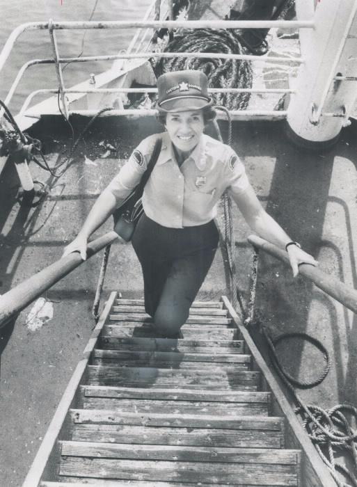 Jean Woolley standing on staris on a pier