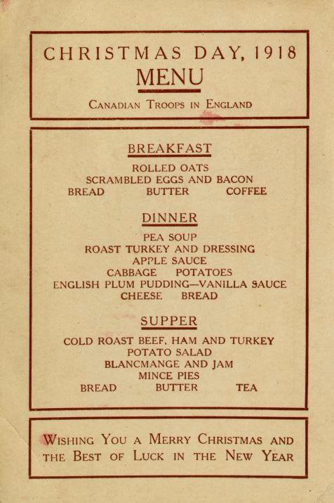 All text postcard that reads Christmas day 1918  menu Canadian troops in England breakfast rolled oats  scrambled eggs and bacon  bread  butter  coffee  dinner pea soup  roast turkey and dressing  apple sauce  cabbage  potatoes