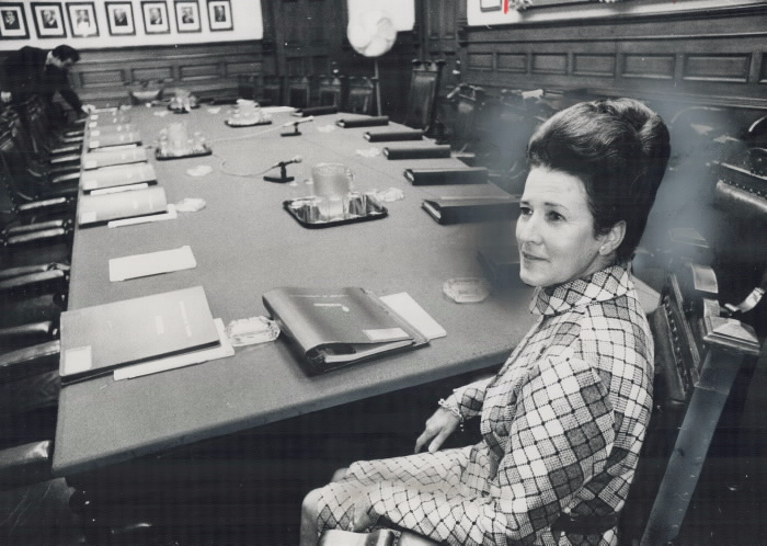 Margaret Birch at the head of a large table