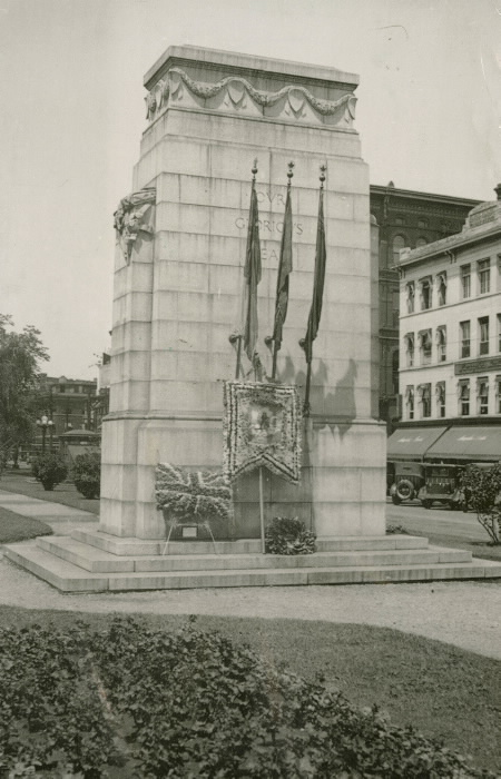 Large stone monument with flags and wreathes
